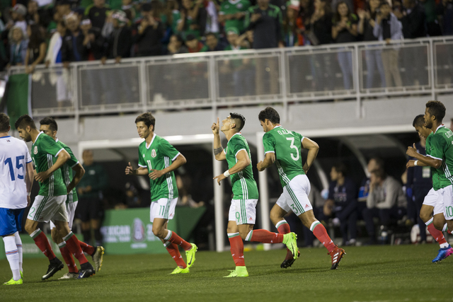 Mexico's Alan Pulido (9), center, celebrates his goal against Iceland in the men's soccer exhibition match at Sam Boyd Stadium on Wednesday, Feb. 8, 2017, in Las Vegas. Mexico won 1-0. (Erik Verdu ...
