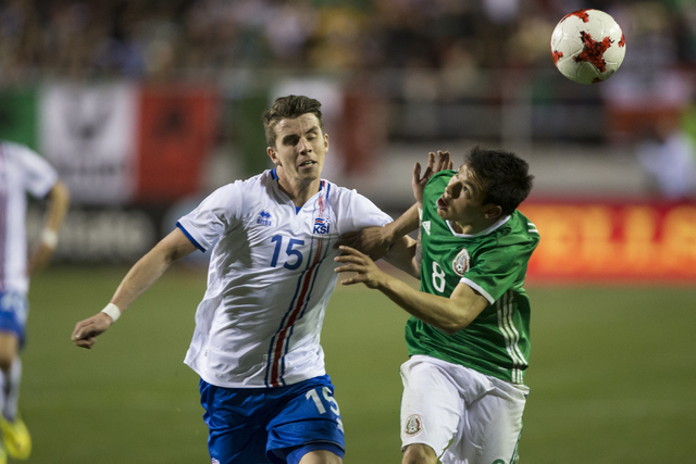 Icelandsճ Vidar Ari Jonsson (15) and Mexicoճ Hirving Lozano (8) run to ball in the men's soccer exhibition match at Sam Boyd Stadium on Wednesday, Feb. 8, 2017, in Las Vegas. Mexico wo ...