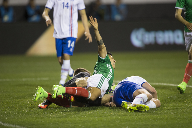 Mexicoճ Alan Pulido (9) calls for a foul against Iceland in the men's soccer exhibition match at Sam Boyd Stadium on Wednesday, Feb. 8, 2017, in Las Vegas. Mexico won 1-0. (Erik Verduzco/Las ...