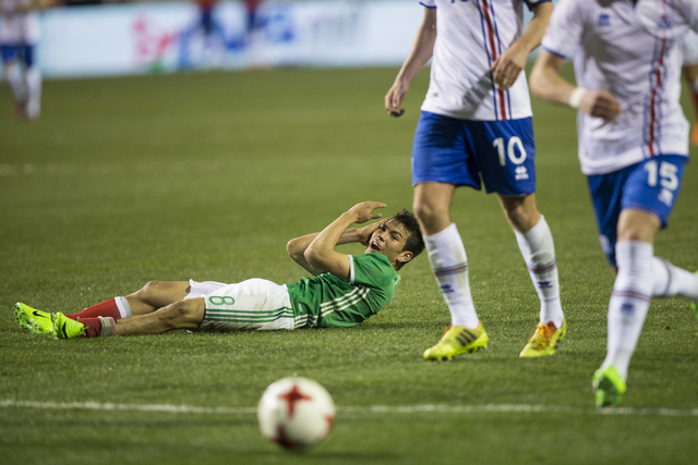 Mexicoճ Hirving Lozano (8) on the ground after getting fouled against Iceland in the men's soccer exhibition match at Sam Boyd Stadium on Wednesday, Feb. 8, 2017, in Las Vegas. Mexico won 1- ...