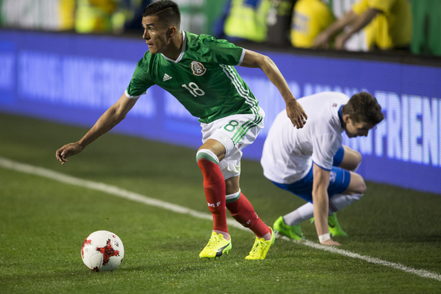 Mexicoճ Luis Reyes (18) looks for an open pass against Iceland in the men's soccer exhibition match at Sam Boyd Stadium on Wednesday, Feb. 8, 2017, in Las Vegas. Mexico won 1-0. (Erik Verduz ...