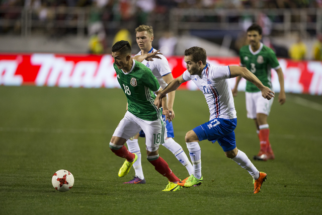 Mexicoճ Luis Reyes (18) runs with the ball against Iceland in the men's soccer exhibition match at Sam Boyd Stadium on Wednesday, Feb. 8, 2017, in Las Vegas. Mexico won 1-0. (Erik Verduzco/L ...