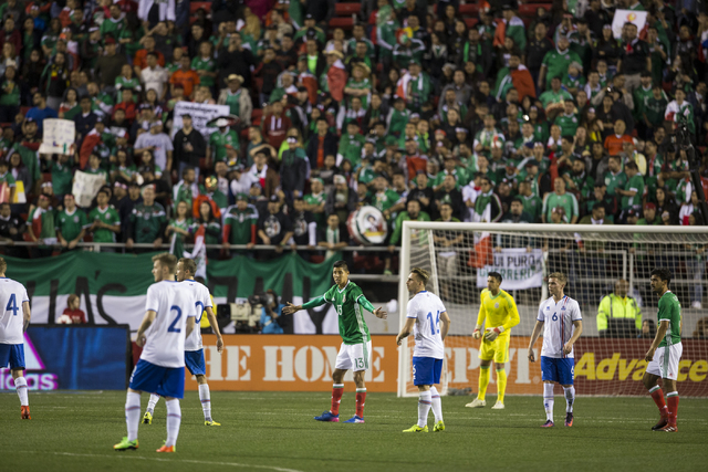 Teams was for play to resume during the men's soccer exhibition match between Mexico and Iceland at Sam Boyd Stadium on Wednesday, Feb. 8, 2017, in Las Vegas. Mexico won 1-0. (Erik Verduzco/Las Ve ...