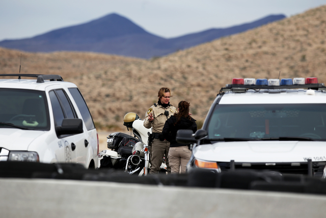 Officers at the scene of an incident at SPEEDVEGAS where two people were killed in a car crash on Sunday, Feb. 12, 2017, in Las Vegas. (Rachel Aston/Las Vegas Review-Journal) @rookie__rae