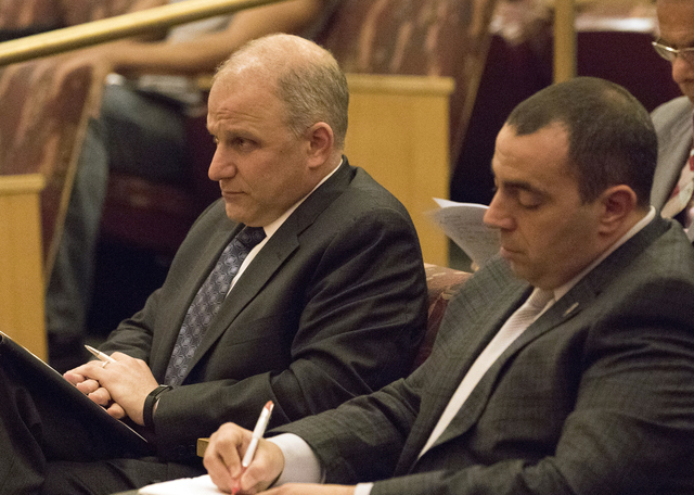 Oakland Raiders legal counsel Dan Ventrelle (right) takes notes prior to team president Marc Badain addressing the Las Vegas Stadium Authority Board at the Clark County Commission Chambers on Feb. ...
