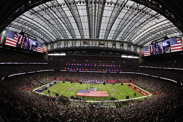 Country music artist Luke Bryan sings the national anthem before the NFL Super Bowl 51 football game between the New England Patriots and the Atlanta Falcons, Sunday, Feb. 5, 2017, in Houston. (AP ...