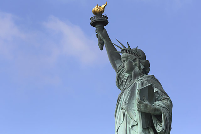 The Statue of Liberty stands against a clear sky Thursday, July 4, 2013. (Mary Altaffer/AP)