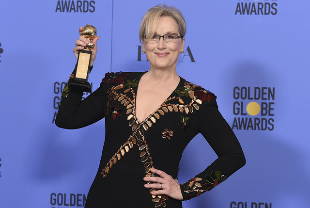 Meryl Streep poses in the press room with the Cecil B. DeMille award at the 74th annual Golden Globe Awards at the Beverly Hilton Hotel on Sunday, Jan. 8, 2017, in Beverly Hills, Calif. (Photo by  ...