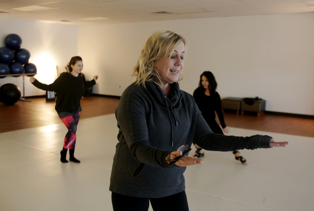 Denise Darnell, owner of the Darnell Dance Works Collective, warms up with fellow instructors on Monday, Feb. 20, 2017, at the Darnell Dance Works Collective dance studio in Las Vegas. (Rachel Ast ...