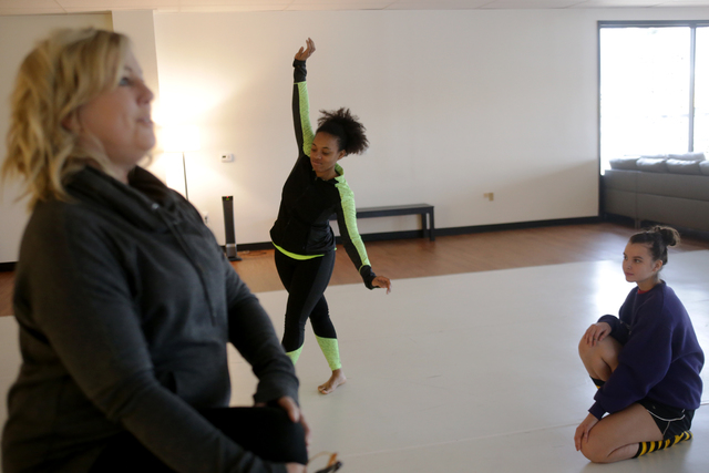 Denise Darnell, owner of the Darnell Dance Works Collective, from left, warms up with fellow instructors Troinetta Nikki and Jana Laubscher on Monday, Feb. 20, 2017, at the Darnell Dance Works Col ...