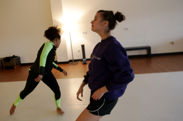 Instructor Troinetta Nikki and Janan Laubscher warm up on Monday, Feb. 20, 2017, at the Darnell Dance Works Collective dance studio in Las Vegas. (Rachel Aston/Las Vegas Review-Journal) @rookie__rae