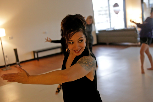 Instructor Jenny Bascos, who specializes in flamenco, leads a warm up session on Monday, Feb. 20, 2017, at the Darnell Dance Works Collective dance studio in Las Vegas. (Rachel Aston/Las Vegas Rev ...