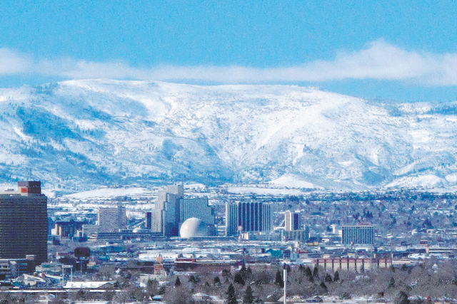 The snow-covered foothills of the Sierra's eastern front are seen beyond the Reno skyline, Feb. 1, 2016. (Scott Sonner/AP)