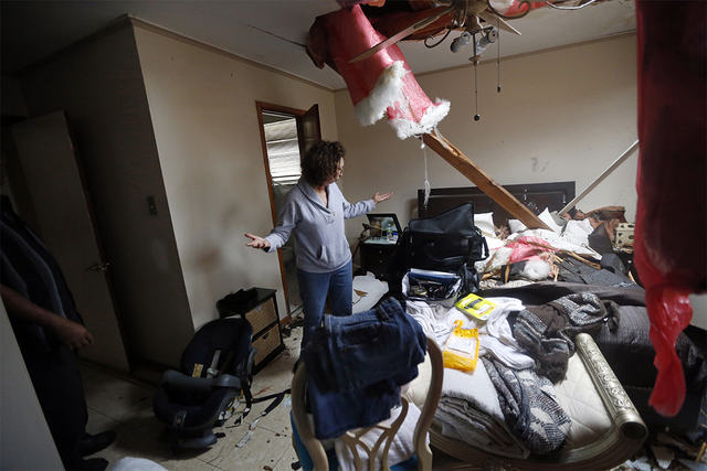 Artie Chaney reacts to her damaged home after a tornado struck while she and family members took cover inside, in the eastern part of New Orleans, Tuesday, Feb. 7, 2017.  The National Weather Serv ...