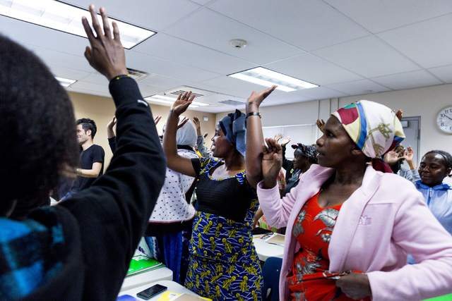 Refugees and students of the Beginners ESL class at Catholic Charities of Southern Nevada, North Las Vegas Blvd. and North Owens Ave., practice the words up and down with actions, Las Vegas, Feb.  ...