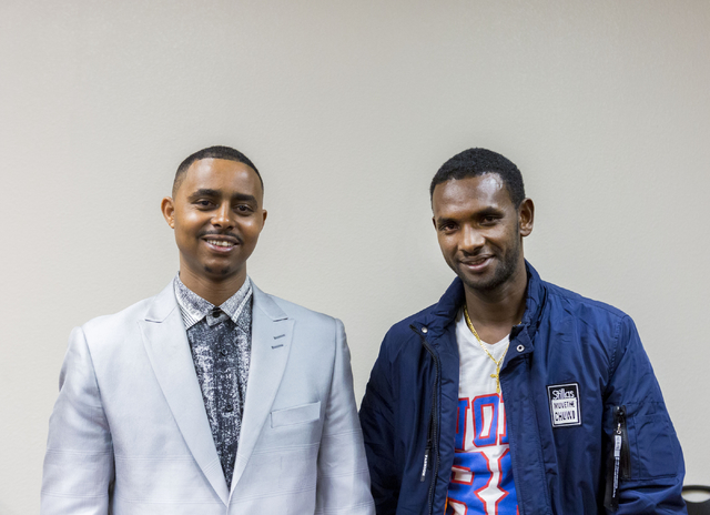 Alexander Tadese, left, and Yemane Gebregiovis, refugees pose for a photo after discussing Tadese's recent move to the U.S. , Catholic Charities of Southern Nevada, North Las Vegas Blvd. and North ...