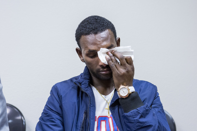 Yemane Gebregiovis, refugee is emotional while discussing his wife and daughter remaining in an Ethiopian refugee camp, while Tadese's just made it to the U.S. , Catholic Charities of Southern Nev ...