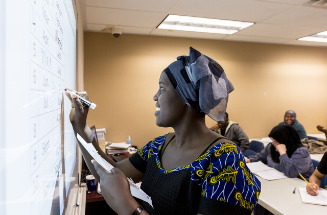 Jadija Irakoze, a student and refugee of the Beginners ESL class at Catholic Charities of Southern Nevada, North Las Vegas Blvd. and North Owens Ave., writes the month June on the board, Las Vegas ...