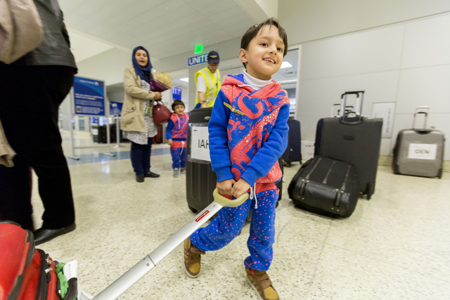 Mohammad Saif, 3, a refugee from Iraq, holds onto his families luggage as they arrive to McCarran International Airport, Las Vegas, Feb. 10, 2017, in wake of Trump's travel ban.  (Elizabeth Brumle ...