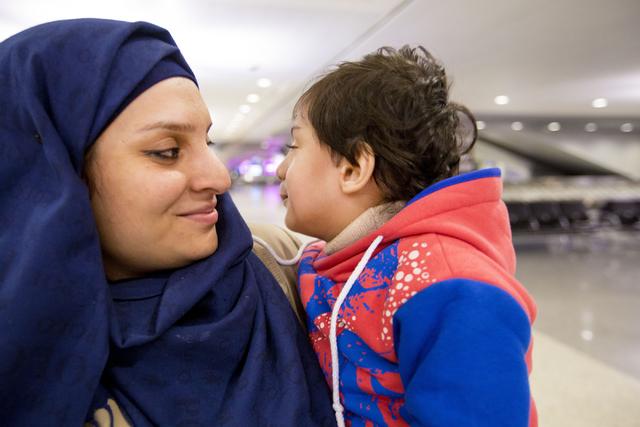 Jamila Sai, refugee from Iraq, holds her son, Murtaza, 2, at  McCarran International Airport, Las Vegas, Feb. 10, 2017 in wake of Trump's travel ban.  (Elizabeth Brumley/Las Vegas Review-Journal)  ...