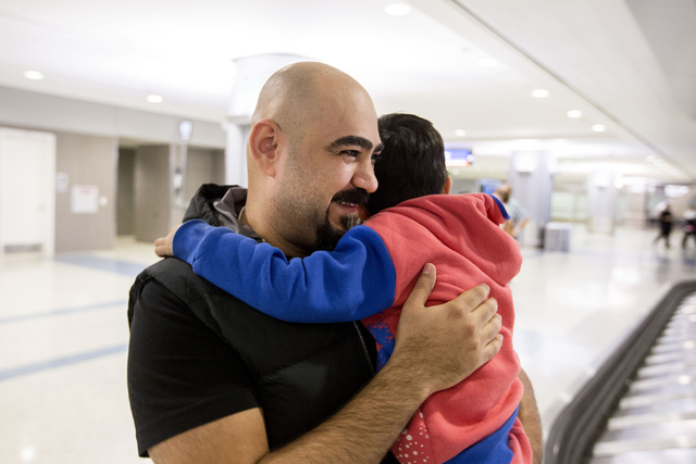 Dhulifiqar Naqvi, refugee from Iraq, holds his young nephew that arrived from Iraq in wake of Trump's travel ban, McCarran International Airport, Las Vegas, Feb. 10, 2017.  (Elizabeth Brumley/Las  ...