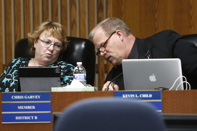 Clark County School Board Trustee Kevin L. Child, right, speaks to Chris Garvey during a board meeting at the Edward A. Greer Center on Thursday, Feb. 23, 2017, in Las Vegas. Childs has insisted t ...
