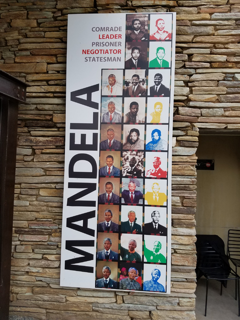 A poster paying tribute to Nelson Mandela in Nelson Mandela Square, Johannesburg, South Africa is seen Saturday, Jan. 28, 2017. The Las Vegas Urban Chamber of Commerce returned Friday from the cha ...