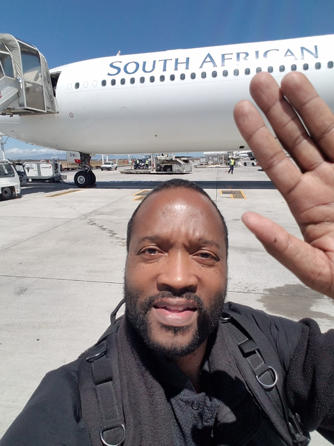 Las Vegas Urban Chamber of Commerce President Ken Evans waves farewell to South Africa as he prepares to board a plane on Thursday, Feb. 2, 2017. The Las Vegas Urban Chamber of Commerce returned F ...