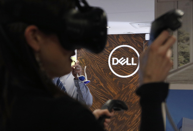 A Dell logo is seen as Jennifer Davies, 31, plays an interactive game during the Destination Dell mobile tour bus event near the Las Vegas City Hall on Wednesday, Feb. 22, 2017, in Las Vegas. (Chr ...