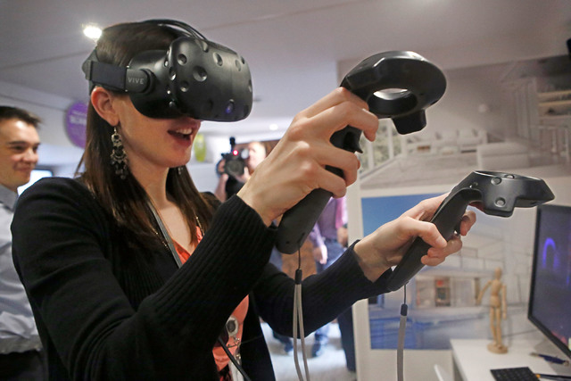 Jennifer Davies, 31, plays an interactive game during the Destination Dell mobile tour bus event near the Las Vegas City Hall on Wednesday, Feb. 22, 2017, in Las Vegas. (Christian K. Lee/Las Vegas ...