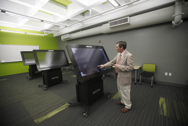 Dr. Jeffrey Fahl, chair of the anatomy department at UNLV, shows the Review-Journal how a virtual anatomy table works on Thursday, Feb. 9, 2017, at UNLV's School of Medicine in Las Vegas. (Rachel  ...