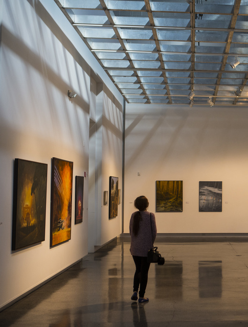 """Chada Kate-Kaew explores the """"Transmutations: Robert Beckmann Under the Western Sky 1977-2017"""" exhibition at Sahara West Library in Las Vegas on Tuesday, Jan. 31, 2017. (Chase Stevens/Las Vegas Re ..."""