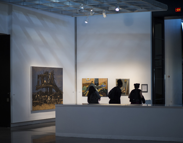 """People look at pieces during the """"Transmutations: Robert Beckmann Under the Western Sky 1977-2017"""" exhibition at Sahara West Library in Las Vegas on Tuesday, Jan. 31, 2017. (Chase Stevens/Las Vega ..."""