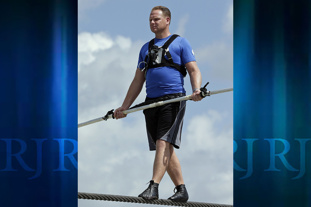 In this June 18, 2013 file photo, high wire performer Nik Wallenda practices in Sarasota, Florida. A stunt involving Wallenda injured five on Wednesday, Feb. 8, 2017, but he wasn't among the injur ...