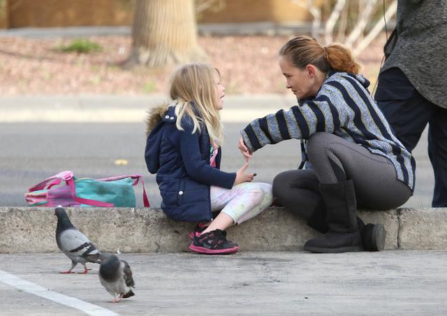 Kira Watts, 8, chats with her mother, Melissa, as she waits for the school bus on Swenson Avenue, Tuesday, Feb. 21, 2017, in Las Vegas. (Bizuayehu Tesfaye/Las Vegas Review-Journal) @bizutesfaye