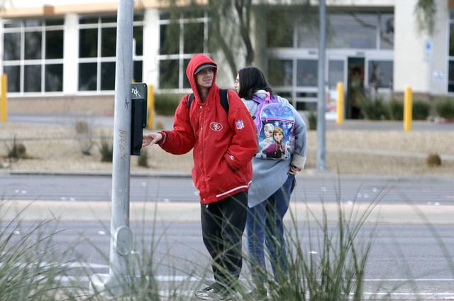 Bundled-up pedestrians wait for traffic lights to cross Boulder Highway on Monday, Feb. 6, 2017, in Henderson. (Bizuayehu Tesfaye/Las Vegas Review-Journal) @bizutesfaye