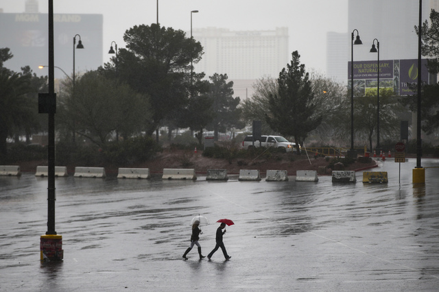 People walk as rain pours down at UNLV in Las Vegas on Saturday, Feb. 18, 2017. (Chase Stevens/Las Vegas Review-Journal) @csstevensphoto