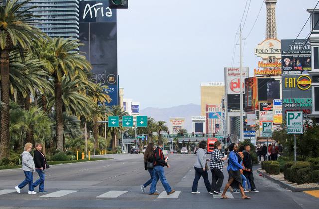 Pedestrians cross Las Vegas Boulevard on the Strip in Las Vegas on an overcast Saturday, Feb. 25, 2017. (Brett Le Blanc/Las Vegas Review-Journal) @bleblancphoto