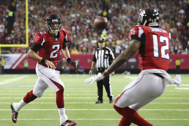 Atlanta Falcons quarterback Matt Ryan tosses a touchdown pass to Mohamed Sanu during the first quarter in the NFL football NFC Championship game against the Green Bay Packers on Sunday, Jan. 22, 2 ...