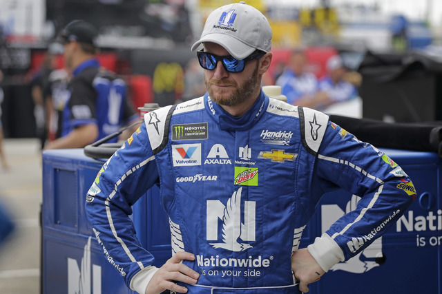 Dale Earnhardt Jr watches crew members work on his car during practice for Sunday's NASCAR Daytona 500 auto race at Daytona International Speedway in Daytona Beach, Fla., Saturday, Feb. 25, 2017.  ...