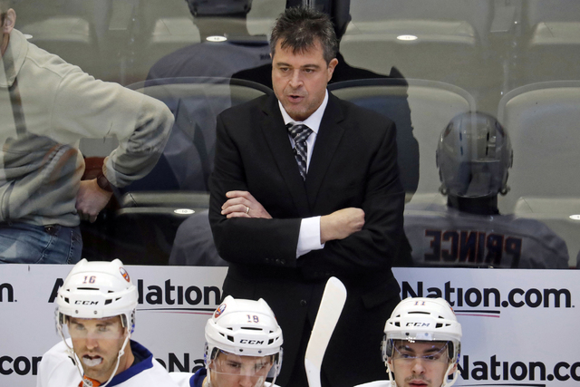 In this Jan. 6, 2017, file photo, New York Islanders head coach Jack Capuano reacts after the Colorado Avalanche scored a goal in the first period of an NHL hockey game in Denver. The struggling i ...