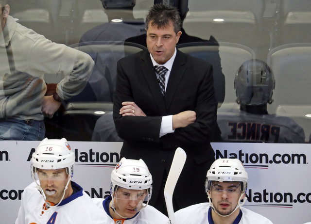FILE - In this Jan. 6, 2017, file photo, New York Islanders head coach Jack Capuano reacts after the Colorado Avalanche scored a goal in the first period of an NHL hockey game in Denver. The strug ...