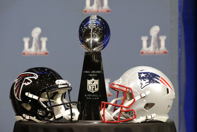 The Vince Lombardi Trophy is seen before NFL Commissioner Roger Goodell's news conference during preparations for the NFL Super Bowl 51 football game Wednesday, Feb. 1, 2017, in Houston. (AP Photo ...