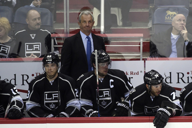 Los Angeles Kings coach Darryl Sutter watches play from the bench during the third period of an NHL hockey game against the Washington Capitals, Sunday, Feb. 5, 2017, in Washington. (AP Photo/Moll ...