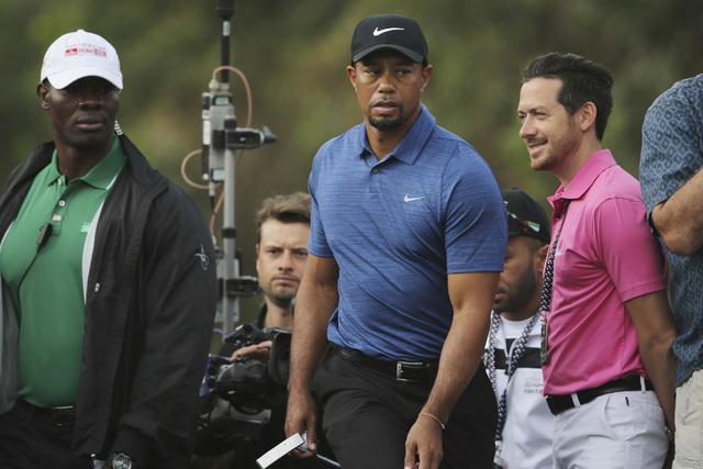 In this Thursday, Feb. 2, 2017 photo, Tiger Woods walking to hole 11th tee shot during the 1st round of the Dubai Desert Classic golf tournament in Dubai, United Arab Emirates. (Kamran Jebreili/Ap)