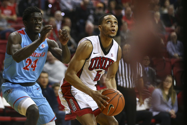 UNLV guard Jalen Poyser (5) looks to shoot as New Mexico guard Damien Jefferson (24) defends during a basketball game at the Thomas & Mack Center in Las Vegas on Wednesday, Feb. 1, 2017. (Chas ...