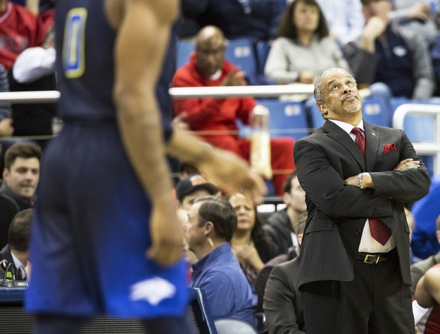 UNLV head coach Marvin Menzies looks up at the scoreboard in the first half of the Rebels road matchup with the Wolf Pack on Wednesday, Feb. 8, 2017, at the Lawlor Events Center, in Reno. (Benjami ...