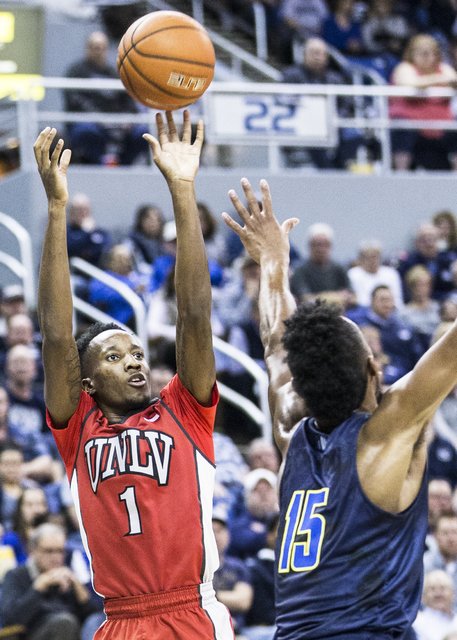 UNLV's Kris Clyburn (1) shoots a corner jump shot over UNR's D.J. Fenner (15) during the Rebel's road matchup with the Wolf Pack on Wednesday, Feb. 8, 2017, at the Lawlor Events Center, in Reno. ( ...