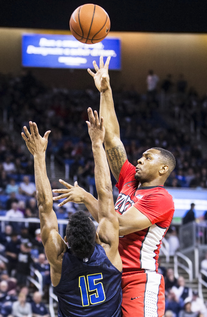 UNLV's Christian Jones (20) shoots a jump hook over UNR's D.J. Fenner (15) during the Rebel's road matchup with the Wolf Pack on Wednesday, Feb. 8, 2017, at the Lawlor Events Center, in Reno. (Ben ...
