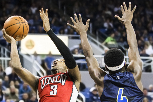 UNLV's Tyrell Green (3) drives past UNR's Devearl Ramsey (4) during the Rebel's road matchup with the Wolf Pack on Wednesday, Feb. 8, 2017, at the Lawlor Events Center, in Reno. (Benjamin Hager/La ...